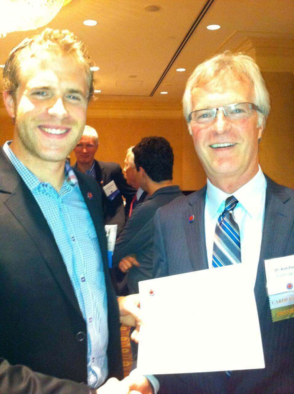 Dr. Seddon Receives his Certificate of Membership to CARDP